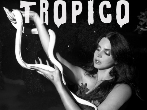 Lana Del Rey poses with a snake as she announces Tropico short film