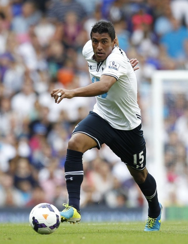 Tottenham Hotspur's Brazilian midfielder Paulinho runs with the ball during the pre-season friendly football match between Tottenham Hotspur and Espanyol at White Hart Lane in north London on August 10, 2013. AFP/Getty Images