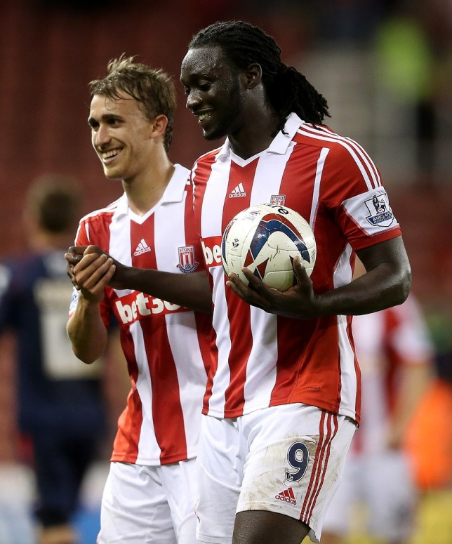 STOKE ON TRENT, ENGLAND - AUGUST 28:  Kenwyne Jones of Stoke celebrates with Marc Muniesa after scoring his hat trick and claiming the match ball during the Capital One Cup Second Round match between Stoke City and Walsall at Britannia Stadium on August 28, 2013 in Stoke on Trent, England. Getty Images