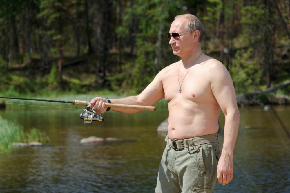 In this photo taken on Saturday, July 20, 2013, Russian President Vladimir Putin fishes during a mini-break in the Siberian Tyva region (also referred to as Tuva), Russia. (AP Photo/RIA-Novosti, Alexei Nikolsky, Presidential Press Service)