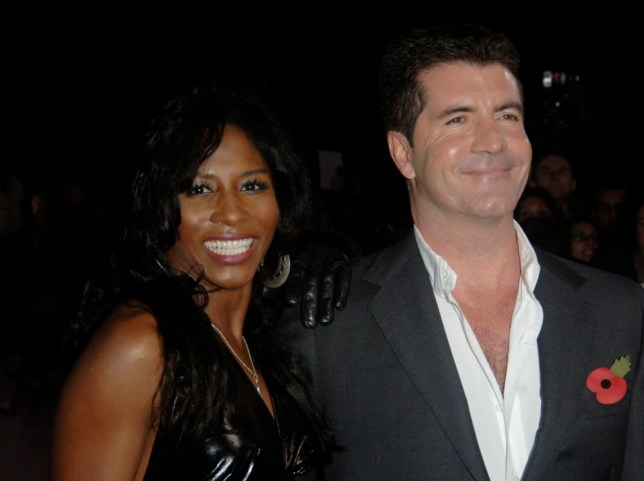 """Singer Sinitta and Simon Cowell pose at the """"National Television Awards"""" at the Royal Albert Hall in London October 31, 2007. REUTERS/Anthony Harvey  (BRITAIN) - RTR1VJAX"""
