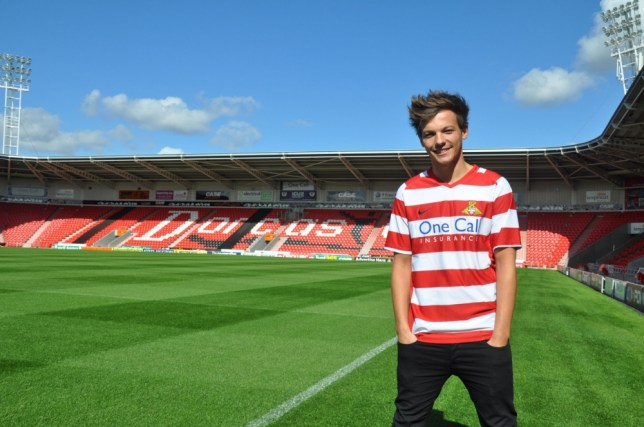 Undated handout photo issued by Doncaster Rovers FC of Louis Tomlinson of One Direction who has signed with the team. PRESS ASSOCIATION Photo. Issue date: Thursday August 1, 2013. The 21-year-old, who once worked at the club as a hospitality waiter, has been issued with the number 28 shirt for the 2013/14 season. He has signed as a non-contract player in aid of Bluebell Wood Children's Hospice in Sheffield. See PA story SHOWBIZ OneDirection. Photo credit should read: Steve Uttley/PA Wire NOTE TO EDITORS: This handout photo may only be used in for editorial reporting purposes for the contemporaneous illustration of events, things or the people in the image or facts mentioned in the caption. Reuse of the picture may require further permission from the copyright holder.