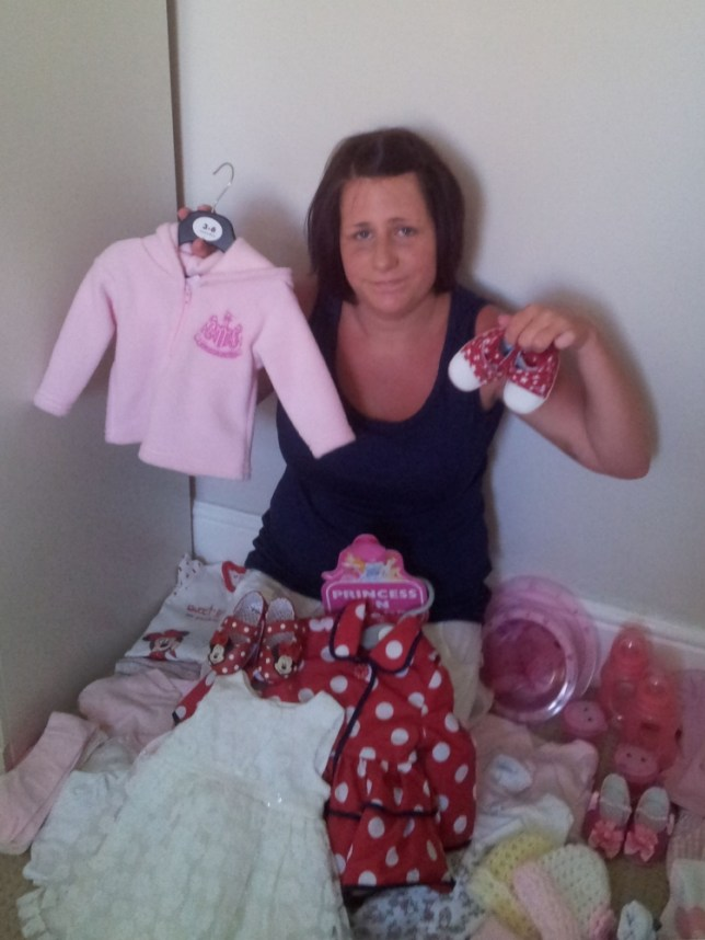 PIC FROM CATERS NEWS - (PICTURED: Sarah Sharples with the girls items) - A first-time mum told by doctors she was having a girl and who splashed out £3,000 on perfect pink essentials is feeling blue after giving birth to a BOY. Broody Sarah Sharples splurged the cash on £500 of pink clothes, £1,000 on pink nursery furniture and £900 on a pink pram. The rest she spent making sure every basic, from the feeding bottles to the bath, were all bought in the traditional girly colour. At her 20-week-scan she was told she was carrying a girl and so immediately started getting prepared. Doting parents Sarah and husband Lee, 37, even decided on a Lily-Mae as a name and had it stencilled on the pink nursery wall. SEE CATERS COPY.
