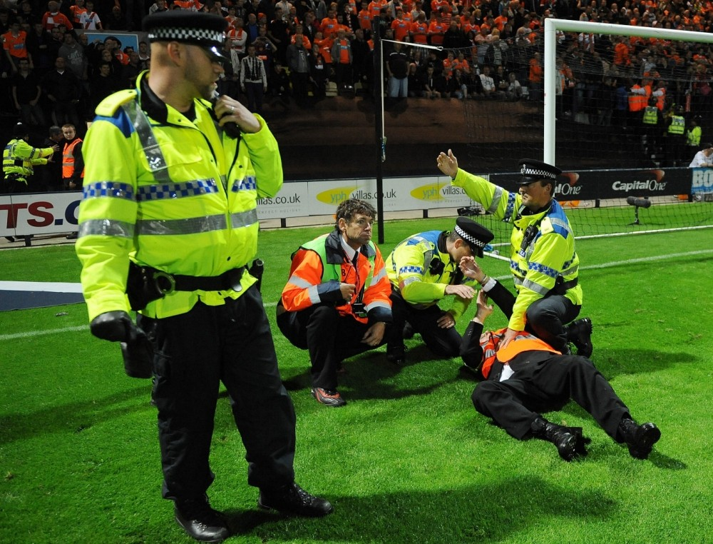 Preston steward trampled by police horse during West Lancashire derby pitch invasion