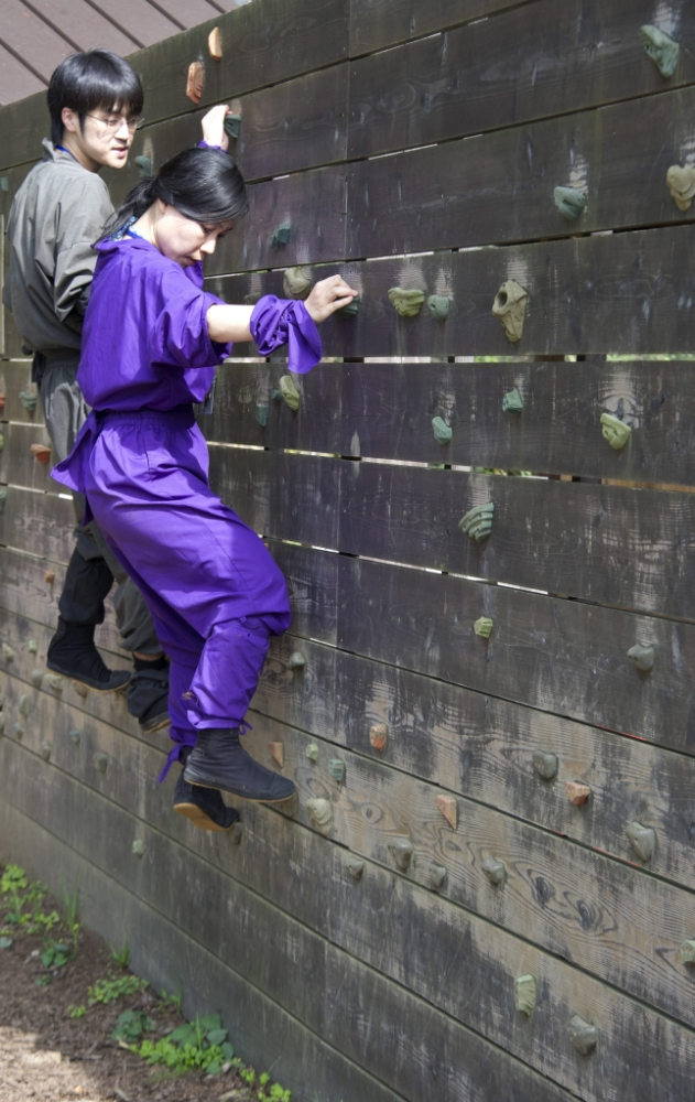 epa03815380 (11/19) Tourists climb across a wall during a ninja training tour in the town of Nabari, Mie prefecture, Japan, 21 July 2013. Nabari is the home of Japanese ninja, which were mercenaries in feudal Japan specializing in espionage, sabotage, infiltration, and assassination. Ninja were most prominent in 15th century Japan. The town of Iga is trying to promote their ninja heritage to attract tourism and improve the faltering economy.  EPA/EVERETT KENNEDY BROWN PLEASE REFER TO ADVISORY NOTICE  (epa03815369) FOR FULL FEATURE TEXT