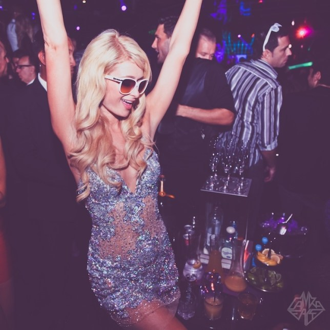 Paris Hilton hand out PR pics to promote DJ residency at Foam and Diamonds at Amnesia Club in Ibiza  Dancig at her birthday party.jpg