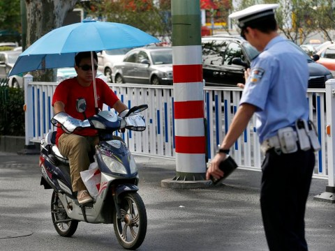 Chinese police target motorbike umbrellas in safety drive