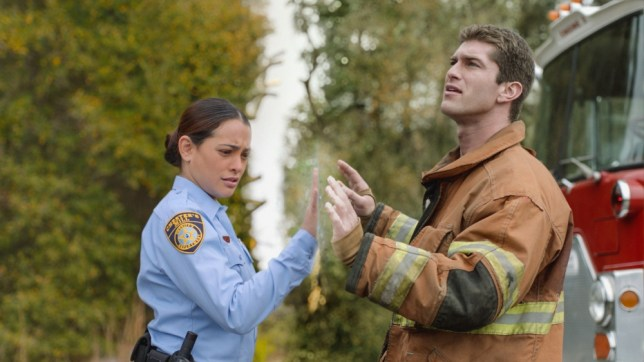 Something comes  between Linda (Natalie Martinez) and her fiance  Rusty (Josh Carter) in Under The Dome (Picture: CBS)
