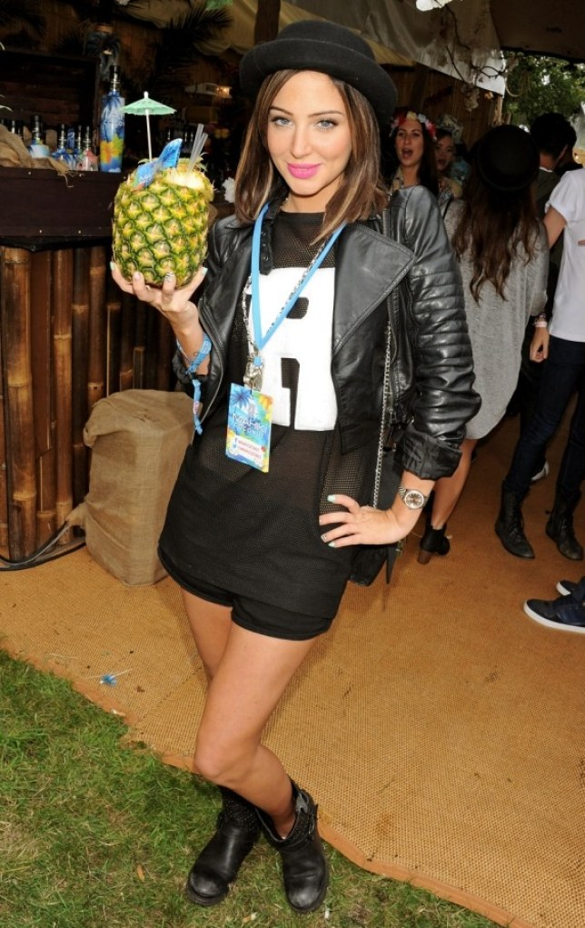 CHELMSFORD, ENGLAND - AUGUST 17:  Tulisa Contostavlos attends the Mahiki Coconut Backstage Bar during day 1 of V Festival 2013 at Hylands Park on August 17, 2013 in Chelmsford, England.  (Photo by David M. Benett/Getty Images for Mahiki Coconut)