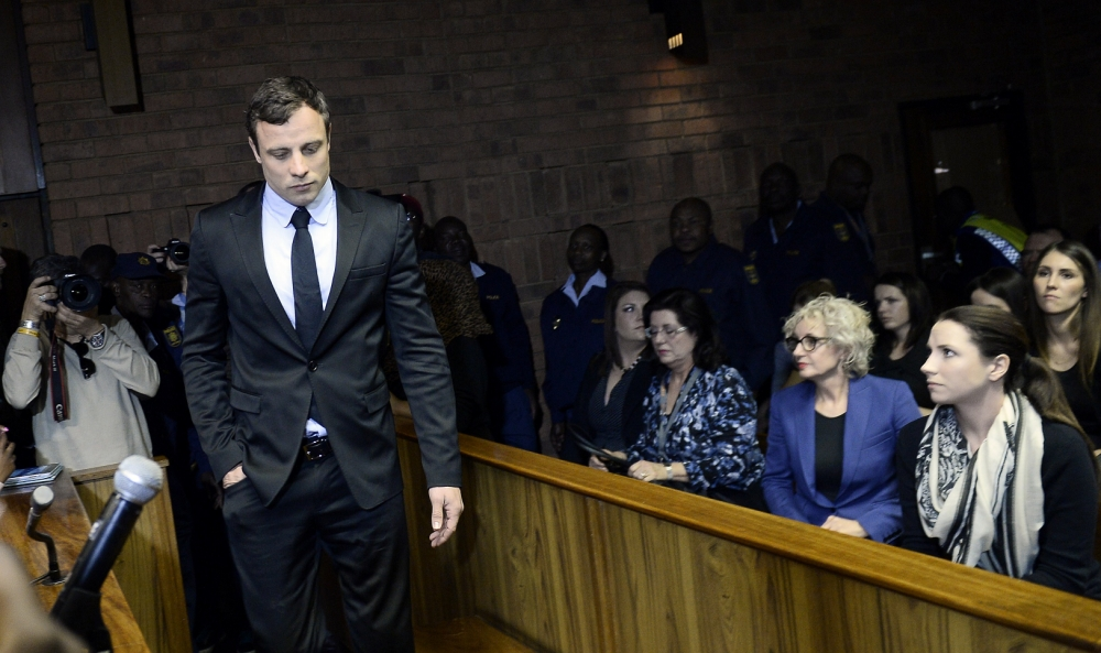 Oscar Pistorius to go on trial in March 2014 charged with murdering his girlfriend Reeva Steenkamp