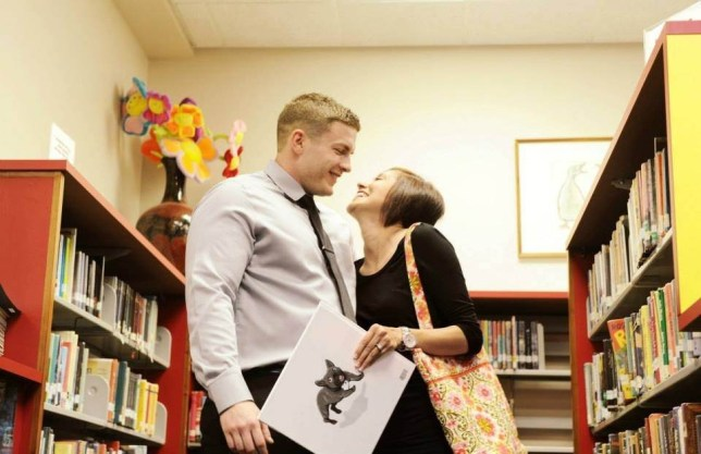 ***BOOK PROPOSAL PIX*** Paul Phillips, 23, asks fiance Erika Ramos, 23, to marry him with a specially-made childrens book during a surprise proposal at the Southern Pines Public Library in North Carolina, USA.