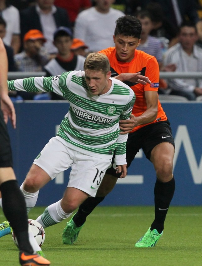 Shakhter's Roger Canas, right, fights for the ball with Celtic's Kris Commons  during their Champions League playoff first leg soccer match in Astana, Kazakhstan, Tuesday, Aug. 20, 2013. (AP Photo/Alexei Filippov)