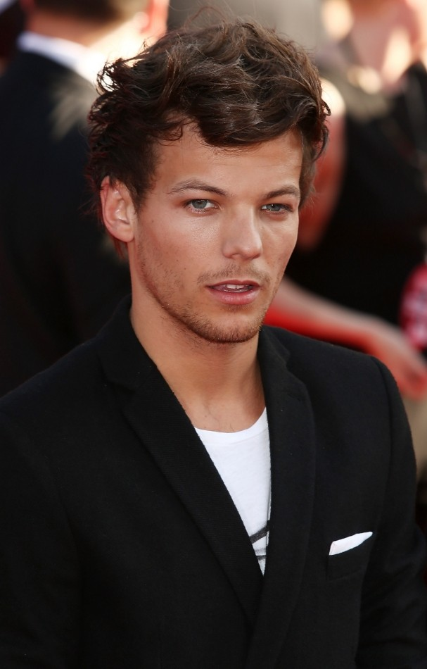 LONDON, ENGLAND - AUGUST 20:  One Direction member Louis Tomlinson attends the World Premiere of 'One Direction: This Is Us' at Empire Leicester Square on August 20, 2013 in London, England.  (Photo by Tim P. Whitby/Getty Images)