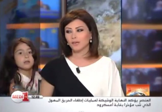 Daughter interrupts mum's live TV broadcast: Little girl tries to