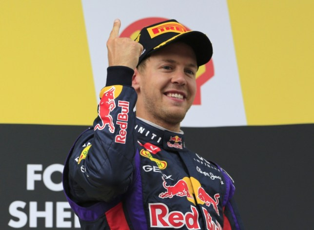 Red Bull Racing's German driver Sebastian Vettel celebrates on the podium at the Spa-Francorchamps ciruit in Spa on August 25, 2013 after the Belgium Formula One Grand Prix.  AFP PHOTO / ALEXANDER KLEINALEXANDER KLEIN/AFP/Getty Images