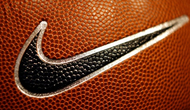 A Nike Swoosh is seen on a basketball at Niketown in Portland, Ore., Tuesday, March 21, 2006.  Nike Inc. is expected to release third-quarter earnings after the close of trading. (AP Photo/Rick Bowmer)