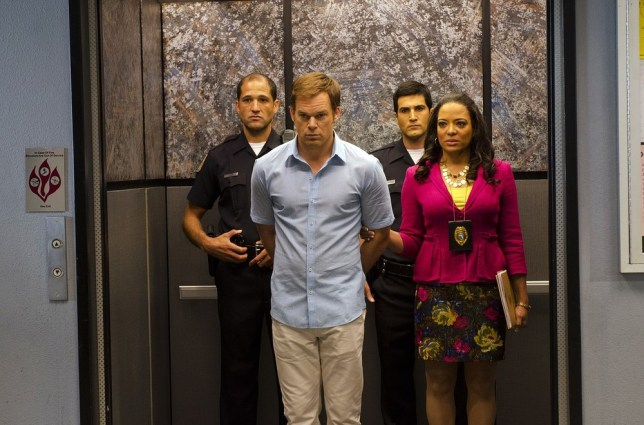 """This undated publicity photo released by Showtime shows Michael C. Hall, front left,  as Dexter Morgan and Lauren Velez as Maria LaGuerta in a scene from  """"Dexter,"""" Season 7, episode 12. The end is coming for """"Dexter,"""" Showtime's serial killer drama. The cable channel said Thursday, April 18, 2013, that the series' upcoming eighth season will be its last. AP"""