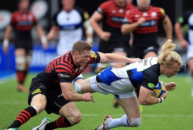 BARNET, ENGLAND - SEPTEMBER 22:  Chris Ashton of Saracens tackles Tom Biggs of Bath during the Aviva Premiership Rugby match between Saracens and Bath at the Allianz Park on September 22, 2013 in Barnet, England. Getty Images
