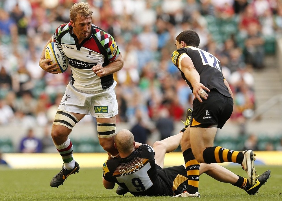 Harlequins' Chris Robshaw (left) is tackled by London Wasps' Joe Simpson (bottom) during the Aviva Premiership match at Twickenham, London. PA Wire/Press Association Images