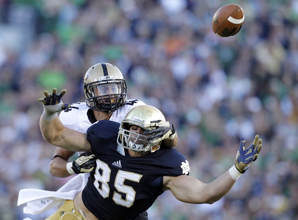 Purdue safety Landon Feichter, behind, breaks up a pass to Notre Dame tight end Troy Niklas during the second half of an NCAA college football game in South Bend, Ind., Saturday, Sept. 8, 2012. Notre Dame defeated Purdue 20-17. AP