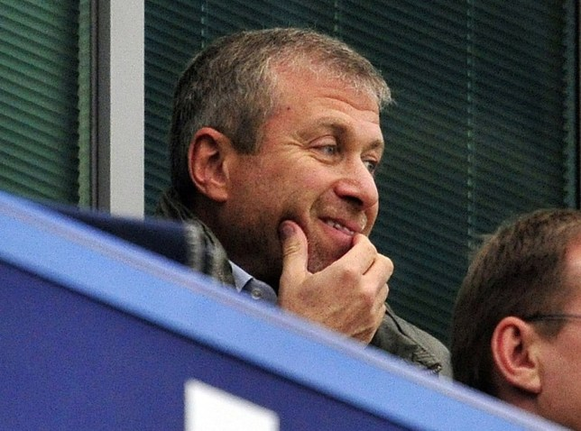 All smiles? Abramovich looks content as he takes his seat ahead of Chelsea's game with Fulham yesterday (Picture: AFP/Getty Images)