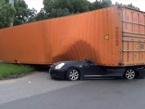 Woman miraculously survives after her car is flattened by giant container