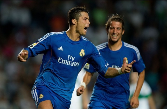 ELCHE, SPAIN - SEPTEMBER 25:  Cristiano Ronaldo of Real Madrid CF celebrates scoring their second goal during the La Liga match between Elche FC and Real Madrid CF at Estadio Manuel Martinez Valero on September 25, 2013 in Elche, Spain.  (Photo by Gonzalo Arroyo Moreno/Getty Images)