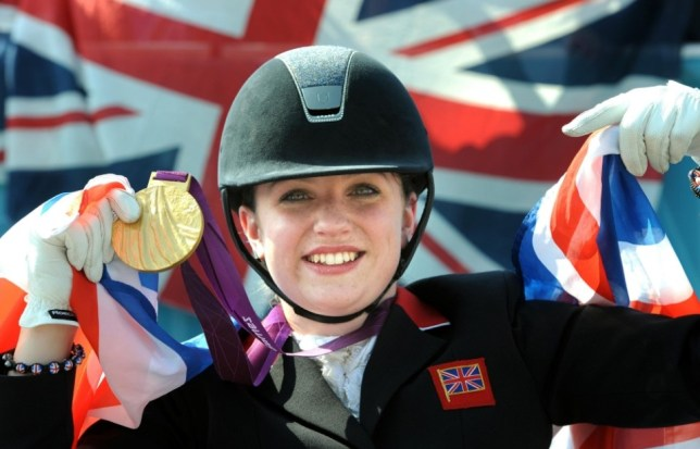 Great Britain's Natasha Baker celebrates winning gold during the Equestrian Dressage Individual Freestyle Test Grade II at Greenwich Park, London