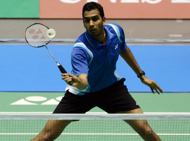 Rajiv Ouseph of England hits a return against Wong Wing Ki of Hong Kong during their men's singles first round match at the Japan Open badminton championships in Tokyo on September 19, 2012. Wong won 21-11, 21-17.    AFP PHOTO / TOSHIFUMI KITAMURA        (Photo credit should read TOSHIFUMI KITAMURA/AFP/GettyImages)