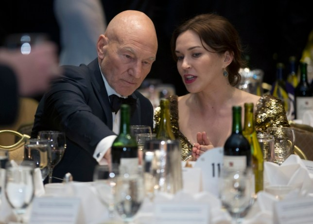 Actor Patrick Stewart, left, and Sunny Ozell attend the White House Correspondents' Association Dinner at the Washington Hilton Hotel, Saturday, April 27, 2013, in Washington.  (AP Photo/Carolyn Kaster)