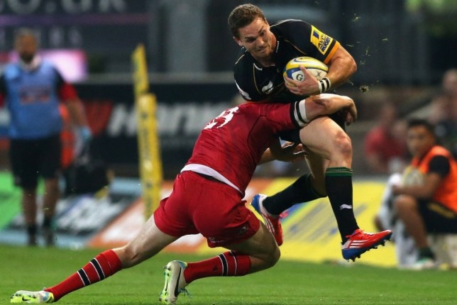 NORTHAMPTON, ENGLAND - AUGUST 23:  George North of Northampton is tackled during the Pre season match between Northampton Saints and Edinburgh Rugby at Franklin's Gardens on August 23, 2013 in Northampton, England.  (Photo by David Rogers/Getty Images)