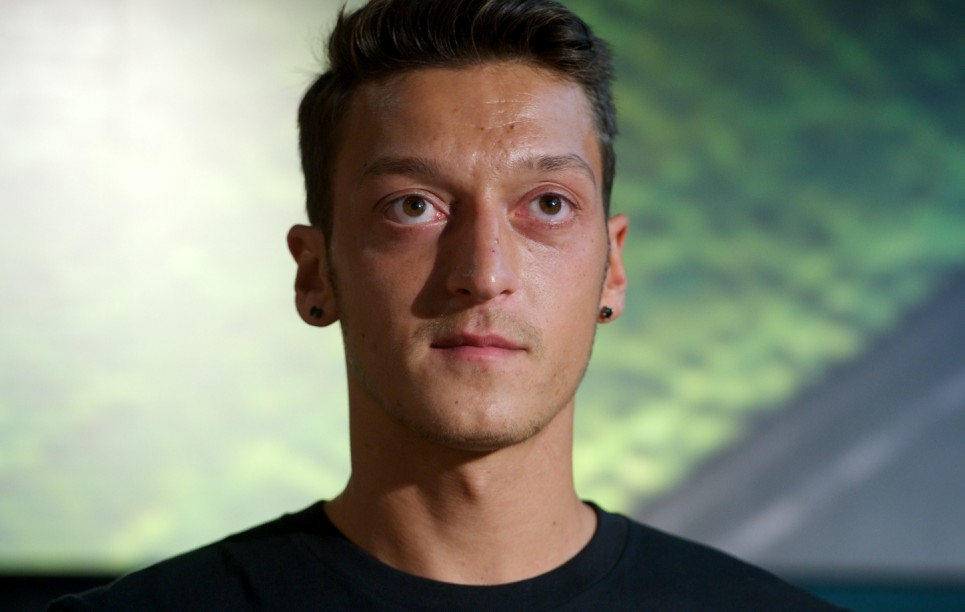 MADRID, SPAIN - AUGUST 28:  Real Madrid's German player Mesut Ozil is presented as the new face of Adidas at Estadio Santiago Bernabeu on August 28, 2013 in Madrid, Spain.  (Photo by Carlos Alvarez/Getty Images)