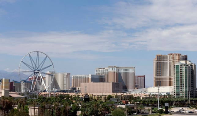 The 55-story High Roller, the world's largest Ferris wheel, left, is under construction near the Las Vegas Strip on Monday, Sept. 9, 2013. Caesars Entertainment Corp. is building the ride, which is expected to open early next year. (AP Photo/Isaac Brekken)