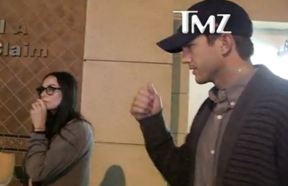 Friends at last? Ashton Kutcher and Demi Moore spotted together again after attending same conference
