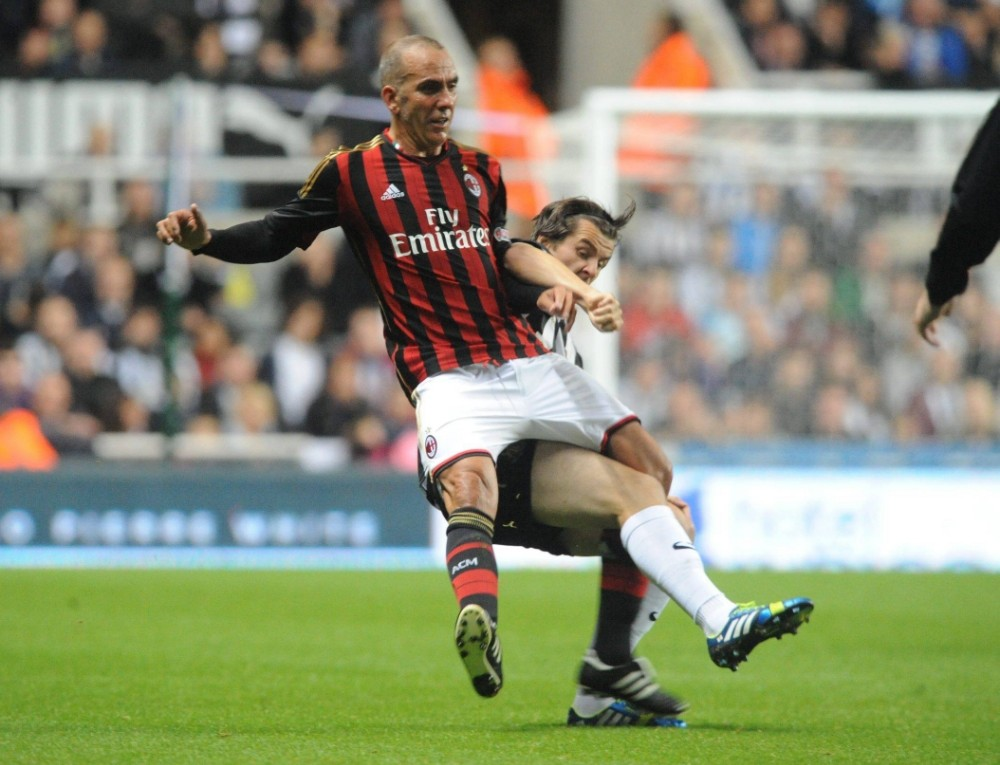 Dated: 11/09/2013  Steve Harper's Testimonial St James' Park ... Joey Barton fouls Paulo Di Canio with a crunching tackle from behind  at tonight's friendly match between Newcastle United Legends and Milan Glory