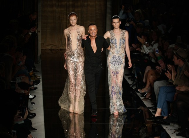 Julien Macdonald with models on the catwalk during his spring/summer London Fashion Week show, at Goldsmiths Hall in London. PRESS ASSOCIATION Photo. Picture date: Saturday 14 September, 2013. Photo credit should read: Yui Mok/PA Wire