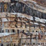 A view taken from the Coast Guard ship on September 18, 2013, shows the right side of the wreck of Italy's Costa Concordia cruise ship after emerging from water, near the harbour of Giglio Porto. Salvage operators in Italy lifted the Costa Concordia cruise ship upright from its watery grave off the island of Giglio in the biggest ever project of its kind. The ship was upright for the first time since the January 13, 2012 tragedy, and led to applause and cheers in the port, in a dramatic climax to the massive salvage operation. Local residents and survivors spoke of an eerie feeling as the ship rose, saying the sight reminded them of the tragedy that claimed 32 lives..    AFP PHOTO / VINCENZO PINTOVINCENZO PINTO/AFP/Getty Images
