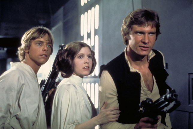"Actors, from left, Mark Hamill as Luke  Film, ""Star Wars: Episode IV, A New Hope""   (1977) Skywalker, Carrie Fisher as Princess Leia and Harrison Ford as Han Solo, appear in a scene from Lucasfilm's ""Star Wars: Episode IV, A New Hope,"" in this undated promotional photo. Lucasfilm Ltd. and 20th Century Fox announced Tuesday, Feb. 10, 2004, that the original three ""Star Wars"" films will be released on DVD on Sept. 21, 2004, in North America. (AP Photo/Lucasfilm, Ltd. & TM)...A...ENT...USA"