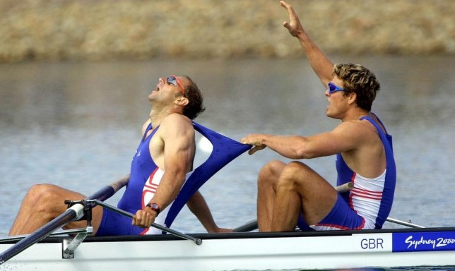 File photo dated 23/09/2000 of Great Britain rower James Cracknell (right) congratulates teammate Steve Redgrave (left) after Team GB won the Gold Medal in the Men's Coxless Four Final at the Olympic Games in Sydney. PA Wire/Press Association Images