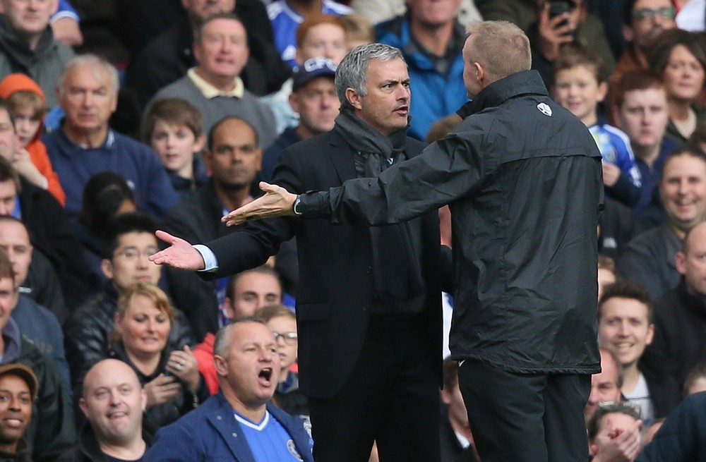 Chelsea's manager Jose Mourinho, left, gestures and looks at the fourth official Trevor Kettle, right, he was then sent off by referee Anthony Taylor during the English Premier League soccer match between Chelsea and Cardiff City at Chelsea's Stamford Bridge stadium in London Saturday,Oct. 19, 2013. AP