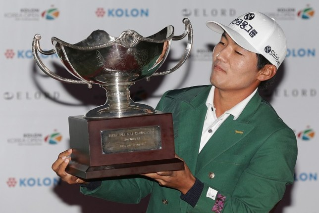 Kang Sung-hoon lifts the trophy at the Korea Open today (Picture: Getty Images)