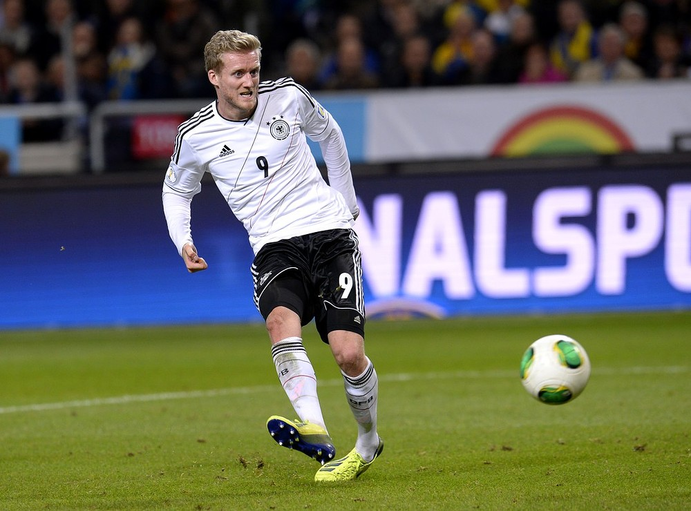 Germany's midfielder Andre Schurrle shoots to score during the FIFA 2014 World Cup group C qualifying football match Sweden vs Germany in Solna, Sweden on October 15, 2013. AFP/Getty Images