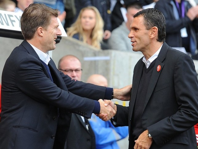 Michael Laudrup and Gus Poyet greet each other at the Liberty Stadium yesterday (Picture: Getty Images)