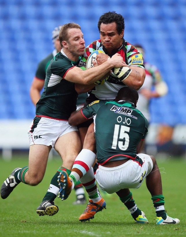 READING, ENGLAND - OCTOBER 05:  Maurie Fa'asavalu of Harlequins is tackled by Thomas O'Leary and Topsy Ojo of London Irish during the Aviva Premiership match between London Irish and Harlequins at Madejski Stadium on October 5, 2013 in Reading, England. Getty Images