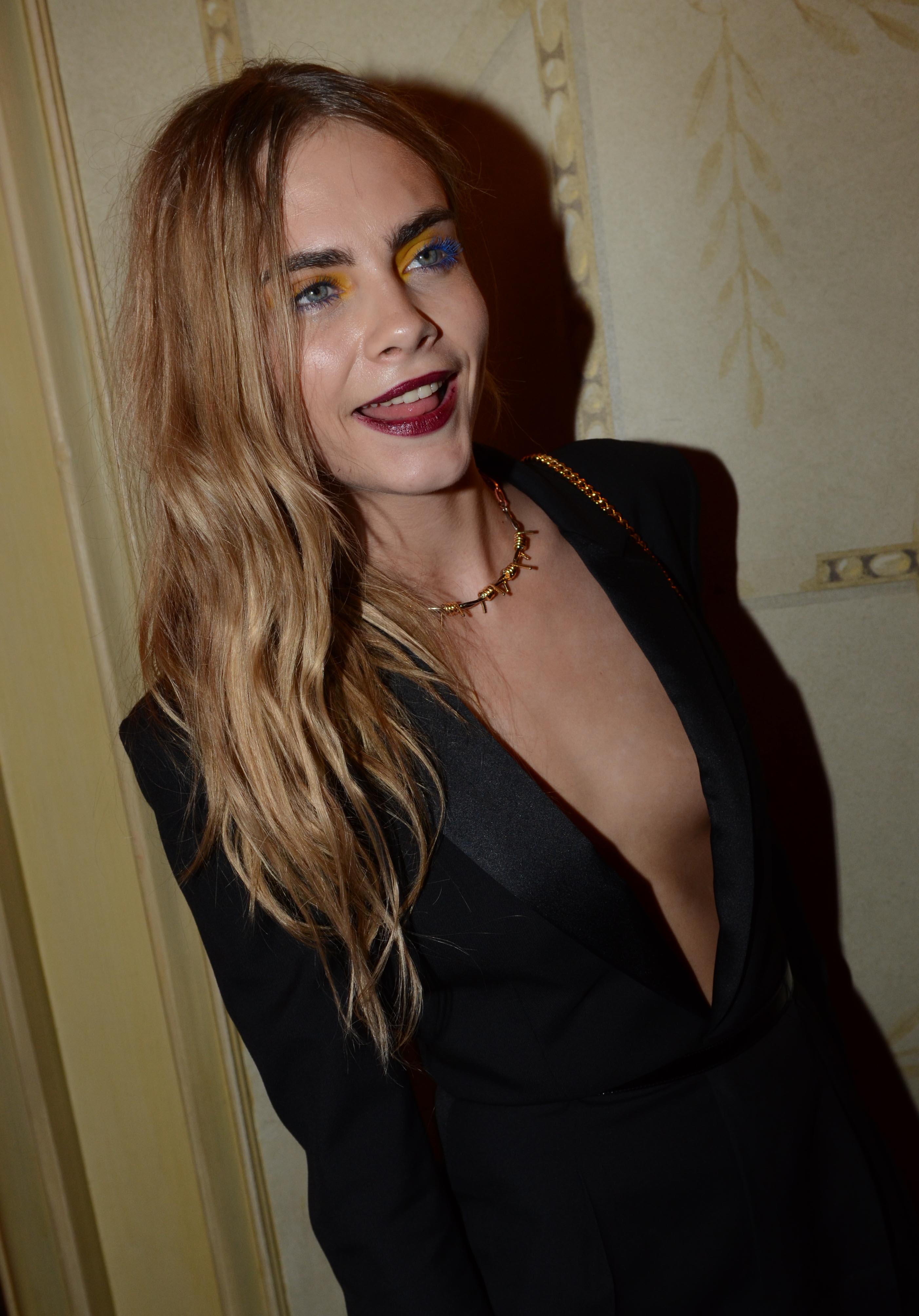 Cara Delevingne has ignored her bosses and had two new tattoos added to her collection (Picture: INFphoto)