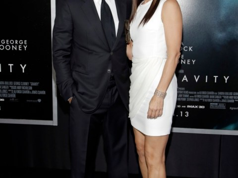 Sandra Bullock jokes that she shares custody of George Clooney with Julia Roberts