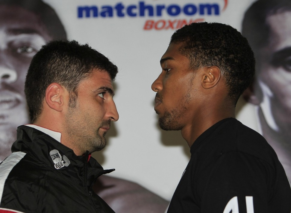 CARPE DIEM PRESS CONFERENCE INTERNATIONAL HOTEL LONDON PIC;LAWRENCE LUSTIG OLYMPIC HEAVYWEIGHT GOLD MEDALIST ANTHONY JOSHUA COMES FACE TO FACE WITH ITALIAN OPPONENT EMANUELE LEO AS HE PREPARES FOR HIS DEBUT AT THE 02 ON SATURDAY