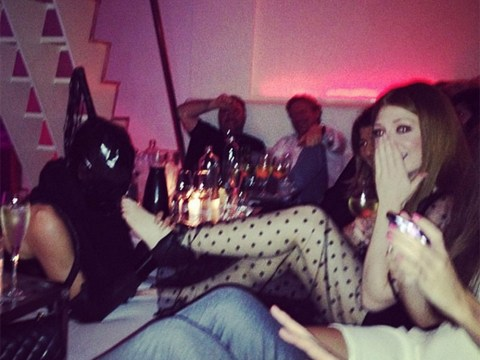 How kinky: Nicola Roberts gets her toes sucked as she celebrates her birthday in Amsterdam