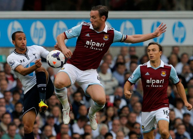 """Tottenham Hotspur's Andros Townsend (L) challenges West Ham United's Mark Noble (C) during their English Premier League soccer match at White Hart Lane in London October 6, 2013. REUTERS/Eddie Keogh  (BRITAIN - Tags: SPORT SOCCER) NO USE WITH UNAUTHORIZED AUDIO, VIDEO, DATA, FIXTURE LISTS, CLUB/LEAGUE LOGOS OR """"LIVE"""" SERVICES. ONLINE IN-MATCH USE LIMITED TO 45 IMAGES, NO VIDEO EMULATION. NO USE IN BETTING, GAMES OR SINGLE CLUB/LEAGUE/PLAYER PUBLICATIONS. FOR EDITORIAL USE ONLY. NOT FOR SALE FOR MARKETING OR ADVERTISING CAMPAIGNS"""
