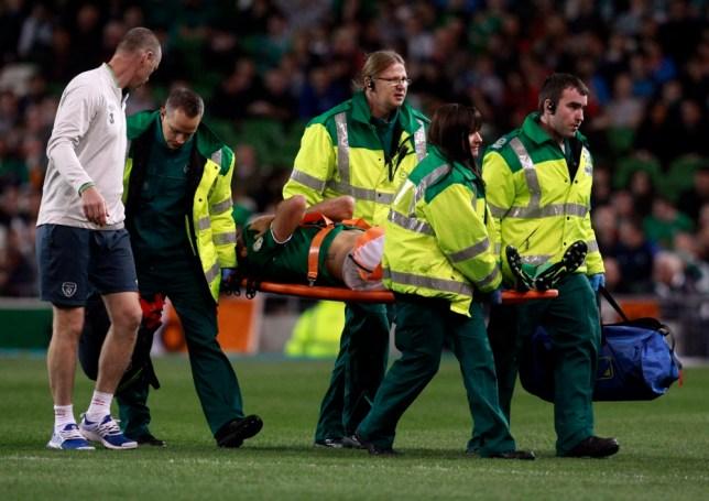 Ireland's Darron Gibson is carried from the pitch on a stretcher after sustaining an injury during the 2014 World Cup qualifying soccer match against Kazakhstan at the Aviva Stadium in Dublin October 15, 2013. REUTERS/Cathal McNaughton (IRELAND - Tags: SPORT SOCCER)